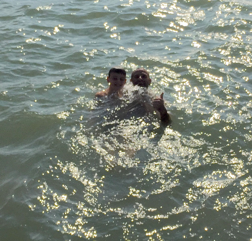 Neil and Zack swimming